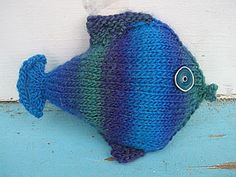 """See more Mochi Plus patterns here.       Mochi Plus  Fishy Fish    Designed by Cathy Campbell for Crystal Palace Yarns    Description:  This little fish uses is a great little project for a child's gift or a fun accent piece for the home.    Level:  Intermediate    Size: Fish's body measures 6.5"""" long, excluding lips and tail and 5.5"""" wide, excluding fins.    Materials:"""