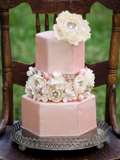 Unique pink wedding cake with ivory flowers