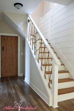 stair door white wall nautical rope stair railing barn door patio door stair gate - New Deko Sites Rope Railing, Staircase Railings, Railing Ideas, Banisters, Staircases, White Shiplap Wall, White Walls, White Wood, Cottage Stairs