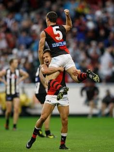 AFL 2012 Rd 05 - Collingwood v Essendon    Brent Stanton of the Bomebers celebrates a goal with Leroy Jetta during the AFL Round 05 ANZAC Day match between the Collingwood Magpies and the Essendon Bombers at the MCG, Melbourne. (Photo: Lachlan Cunningham/AFL Photos) AFL Media — at Melbourne Cricket Ground (MCG).