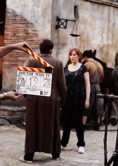 """David Tennant, Catherine Tate. (So, is it a bad thing that I can tell this scene is from the Fires of Pompeii, specifically the """"Donna, human, no"""" exchange?)"""