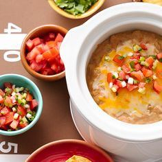 Easy three ingredient bean dip: refried beans, green chiles and cheese in the Slow Cooker, and it's hot and ready when you need it!