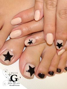 nude nails w/ black star designs. matching manicure & pedicure design.