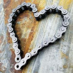 Some chain art for you!! Chain art, metal hearts, motorcycle decor, motorcycle chain heart, biker wedding, motorcycle wedding gift, industrial decor, rustic hearts, metal art, weld art