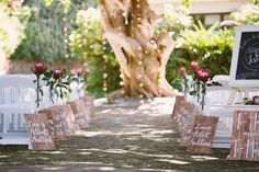 Love messages as decor down the isle! Photo by  Lad & Lass Wedding Photography.