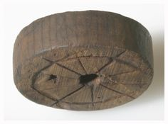 Runic inscription: Nikulás loves so much the woman called Gýríðr, the stepdaughter of Pitas-Ragna.' Decorated wooden wheel (spindle whorl) from Oslo. 1100s/1200s?