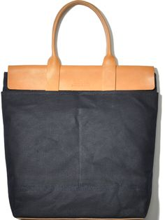 Fancy - Tote Bag by Jardins Florian  UNISEX TOTE BAG by JARDINS FLORIAN  Craftsmanship:Handmade / U.S. made: Handcrafted in the USA using domestic waxed canvas and hand burnished vegetable tanned leather.  http://fancy.to/u0pvu