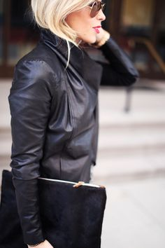 Leather bomber jacket, clutch and aviators