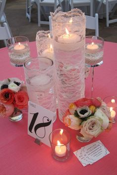 neat idea... I'd want number of table much higher so it can been seen from far away but lacy candles are nice. I think I want grey table clothes with coral/peach flowers... maybe babies breath and some greenery too.