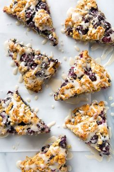 Simple scones that are studded with juicy blueberries and scented with lemon and vanilla. These vegan blueberry scones are lower fat and lightly sweetened.