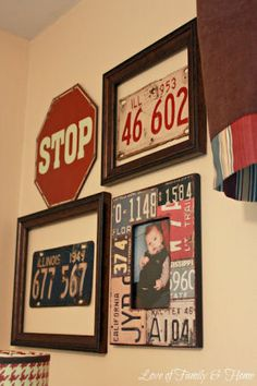 Baby boy gallery nursery wall display including including framed vintage car tags and street signs