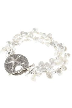 Three interwoven strands of Freshwater Keshi pearls, mother of pearl and Swarovski crystals are paired with a fine silver sand dollar toggle clasp (99.9% pure silver, Fair Trade). Handcrafted in 3 sizes: Small: 7 inches Medium: 7.5 inches Large: 8 inches  Plantation Bracelet by Moonrise Jewelry. Accessories - Jewelry - Bracelets Virginia