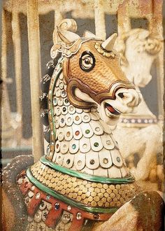 carousel horse.  I know most think of balls and parades, but I think of carousels when I think of a carnivale <3