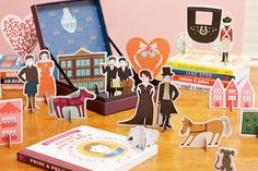 Pride & Prejudice Playset: The Pride & Prejudice playset includes the original board book, as well as seven punch-out cards full of characters and scene elements for a day full of play