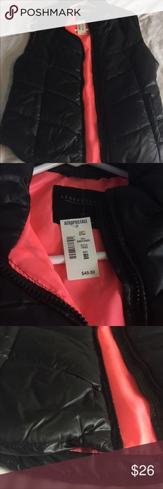 Puffy Vest This is a black with hot pink in the middle puffy vest perfect for fall and winter! It is also brand new (never worn) and still has the tags! It looks very cute with a flat outfit to add some extra texture. The zippers also work perfectly with no problems! Aeropostale Jackets & Coats Vests