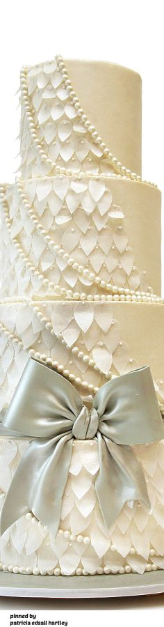 Gorgeous wedding cake with pearl and leaf details