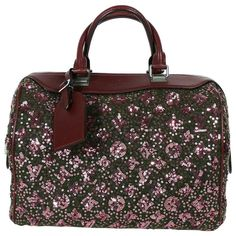 Louis Vuitton Speedy Sunshine Express Burgundy Sequin Monogram Limited Edition   From a collection of rare vintage top handle bags at https://www.1stdibs.com/fashion/handbags-purses-bags/top-handle-bags/