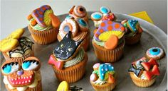 #Halloween_Pop_Cupcakes  Imaginative and colorful food design.  A fun way to celebrate fall.