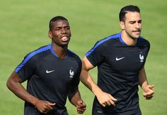 France's midfielder Paul Pogba (L) and France's defender Adil Rami run at their training ground in Clairefontaine-en-Yvelines, southwest of Paris, on June 6, 2016, ahead of the beginning of the Euro 2016 football tournament. / AFP / FRANCK FIFE