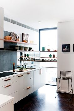Open shelving in the kitchen. Also love those floors and cabinet handles.