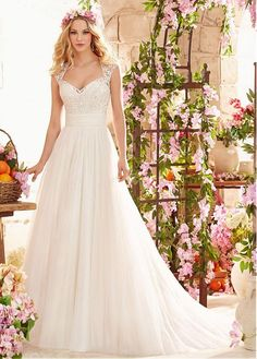 Stunning tulle queen anne neckline a-line wedding dress with embroidery. This a line dress is classic, soft and delicate. Be a queen in this dress in your big day!
