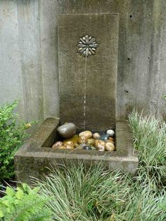 cast concrete fountain with pebble mosaic insert by Jeffrey Bale.
