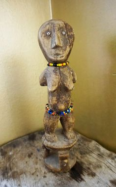 Vintage African fertility doll , Congo, Yaka people by BeyondDesignStudio on Etsy Fertility Symbols, Congo, African Art, Pots, Glass Beads, Lion Sculpture, Clay, Statue, Antiques