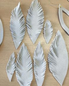 Cutting the felt feathers #milliner #cocktailhat #millinery #exclusivehats #felthat