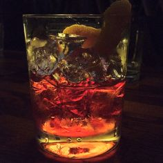 Negroni. equal parts, campari, sweet vermouth, gin, orange slice