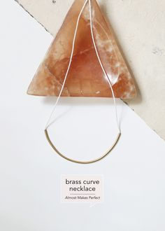brass-curve-necklace-Almost-Makes-Perfect-Design-Crush