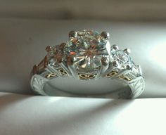 De Kara platinum and 18 karat yellow gold diamond engagement ring