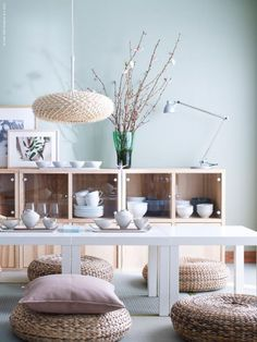 Japan-inspired IKEA interior with TRÄBY cabinets, IKEA PS VAVA lamp, rattan stools ALSEDA and low LACK tables.