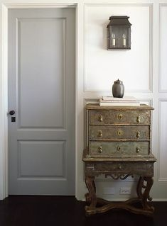 This is my favorite look. A slightly darker colored door with doorframes, baseboards and walls that are painted the same lighter shade. Thoughts?