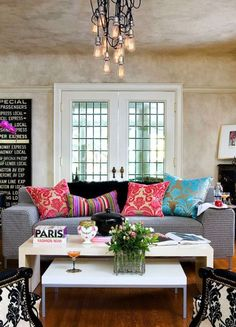 Stylish living room in neutrals transformed with few floral cushions - spring inspired home