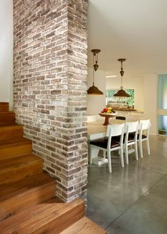 Dining room with polish concrete floor - Brick wall - Wood stairs
