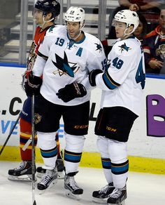 San Jose Sharks forward Joe Thornton stands with linemate Tomas Hertl after scoring a third period goal (Nov. 11, 2014).