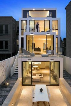Modern architecture. I love the warm light you see in these newer designs, it turns something cold into something cozy.