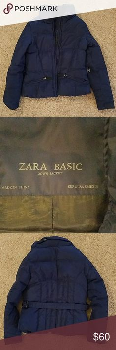 Zara basic winter down jacket - small Navy blue belted small down jacket. Had this for a couple years and recently been sitting in the closet. Warm for the winter and has a hidden hood. Other than the frayed tag(care instructions) and scratches hidden behind the belt buckle, if you dry clean, it has lots of wear left! Zara Jackets & Coats
