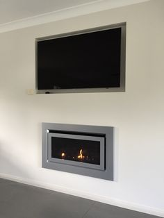 Escea gas fireplace. Built into a Timber cavity with a TV mounted above. Five Star Fireplaces installed this.