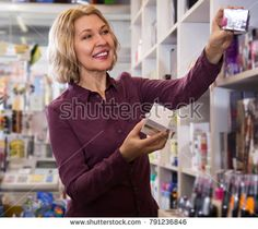 mature female offering cream in the store cosmetics