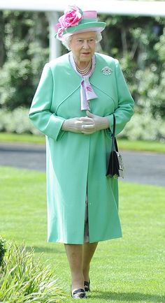 Lovely: The Queen looked summery with a floral print lilac blouse beneath her green coat, Ascot, 19th June 2013