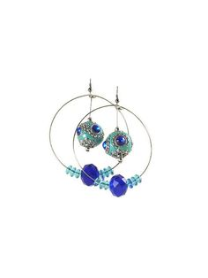 These large #HoopEarrings are made with memory wire and glass beads.  There is 1 #ChunkyBead that hangs down in the middle.  The hoops are about 2 inches wide. #taraelisabethdesigns #Handmade #HandmadeJewelry #Jewelry #FashionJewelry