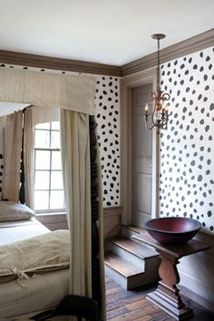 beautiful bed, beautiful trim, beautiful floors (...interesting walls...)