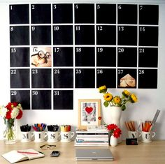 you could do this larger, and use magnetic numbers, and magnetic blackboard paint so you can stick things to the dates!