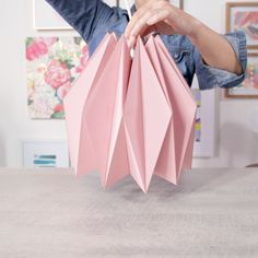 Transform Paper into an Amazing DIY Origami Pendant Skip the lighting aisle at the hardware store and make your own affordable pendant with this DIY modern paper lampshade. This project involves. Origami Design, Diy Origami, Origami Lampshade, Paper Lampshade, Paper Crafts Origami, Lampshades, Origami Wall Art, Make A Lampshade, Lampshade Ideas
