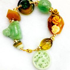 A Perfect Charm to fight setbacks and obstacles. Made of natural Jade, Flourite, Agate, Citrine and Swarovski
