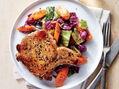 A generous side of fresh veggies makes hearty comfort food lighter. Super-succulent pork chops are browned on the stovetop before being f...