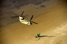 A US Army CH-47 Chinook helicopter prepares to tote a 14,000 pound buoy that washed ashore south of Tillamook Bay in Garibaldi, Oregon. : MilitaryPorn