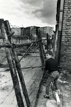 a young boy at the berlin wall, (the west), 1965 ...