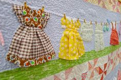 ooooh dresses on a quilt!  brilliant!